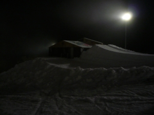 The Dew Hut set-up Wednesday under lights with a few jumps pushed up. The closest jump send the riders rightover the hut. Behind that riders can get onto the roof and the final jump sends the rider onto the roof rail.